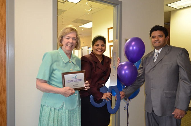 Eileen Curtis, president of Dulles Regional Chamber of Commerce, welcomes Pinky Khatri, doctor of audiology, and her husband Pradeep Khatri.