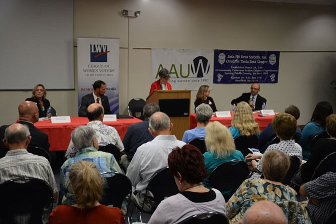 From left: Candidates for Mount Vernon District supervisor Jane Gandee (R), Dan Storck (D) and for Fairfax County School Board Mount Vernon representative Karen Corbett Sanders and W. Anthony Stacy participated in a question-answer session hosted by the League of Women Voters.
