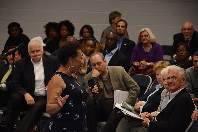 Commissioner Shirley Ginwright, chairman, Communities of Trust Committee and president of the Fairfax County chapter of the National Association for the Advancement of Colored People, responds to protesters for Natasha McKenna at the public forum of the Fairfax County police practices review commission.
