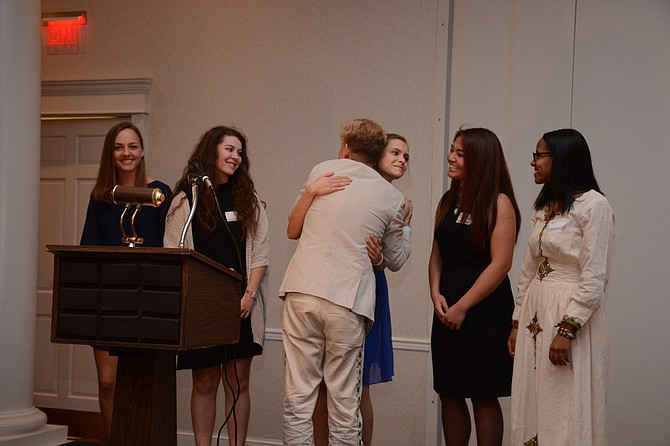 (From left) J.E.B. Stuart High School seniors Anna Rowan, Cassie Marcotty, Marley Finley, Abby Conde and Lidia Amanuel accept the Fairfax County NAACP president's award recognizing their Students for Change petition to change the name of their school to Thurgood Marshall.