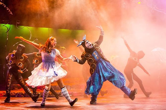 "Kathy Gordon stars as Alice and Vato Tsikurishvili stars as the Caterpillar in Synetic Theater's production of ""Alice in Wonderland."""