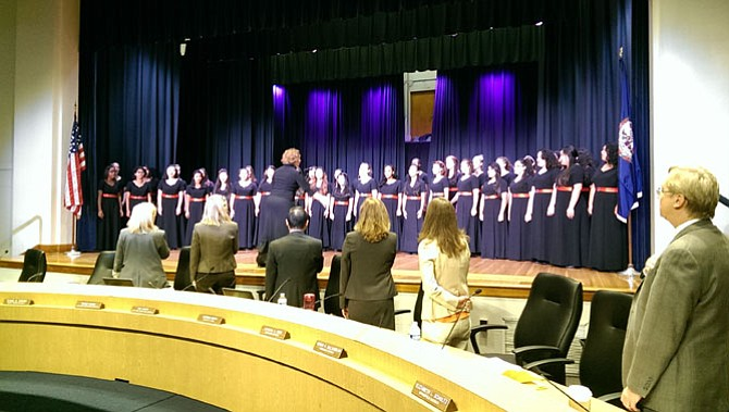 Members of the Select Women's Ensemble of Annandale High School perform the National Anthem to open the Sept. 24 Fairfax County School Board meeting.