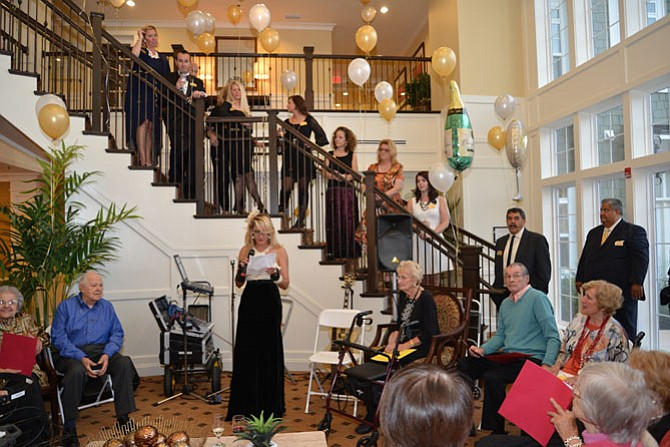 Brightview Great Falls executive director Tina Aulakh gave the welcome speech and made the toasts, surrounded by her staff on the stairs above her. Then it was on to leading the gathering in a few rousing tunes before getting the dancing underway.