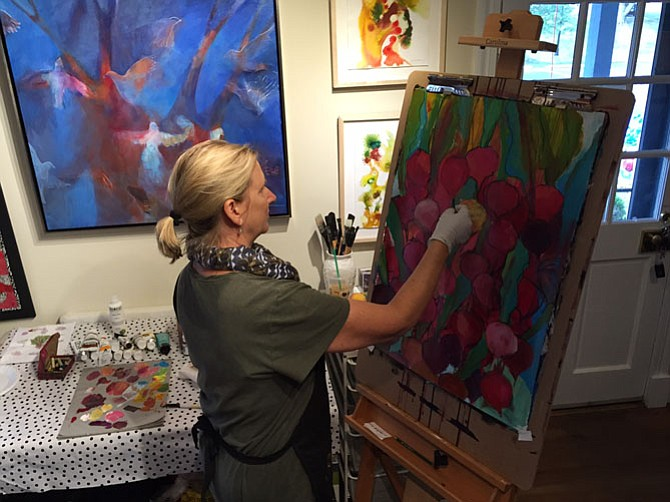 Jennifer Duncan adding charcoal line to mixed-media painting