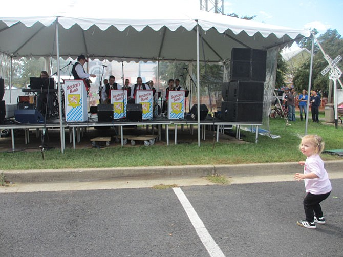 The Oktoberfest celebration features food, live music on two stages, children's activities, marketplace vendors, and a beer tent. Even little kids want to dance to the oom-pah music.