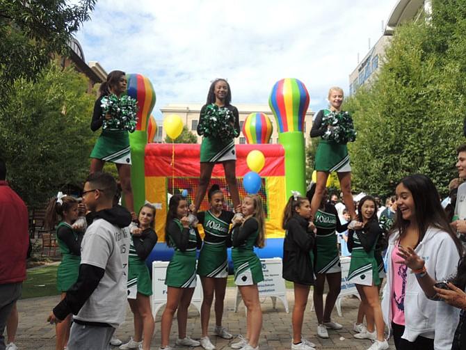 Walter Johnson cheerleaders salute the crowd of walkers.
