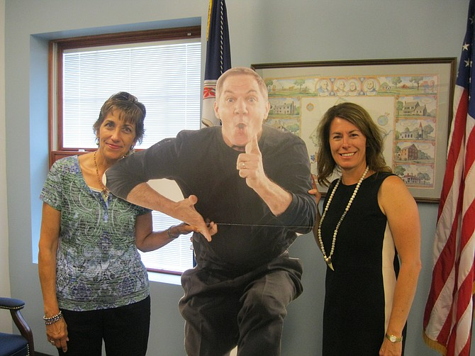 """Shepherd's Center of Oakton-Vienna Director Michelle Scott and Vienna Mayor Laurie diRocco spend a moment with """"flat Mack,"""" a cut-out image of Mack Dryden, nationally-known headliner for SCOV's annual benefit fundraiser on Oct. 26."""
