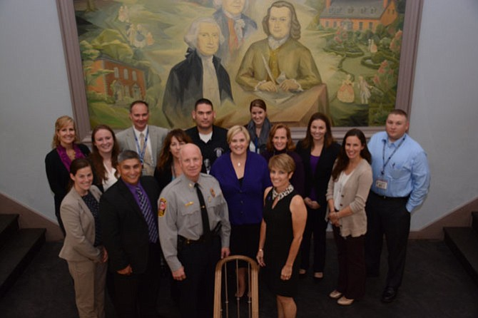 Members of the Fairfax County Police Department, Department of Family Services, Office for Women and Domestic Violence Services, and domestic violence detectives gathered at the Historic Fairfax Courthouse to mark the launch of a new Lethality Assessment Program for victims of domestic violence.