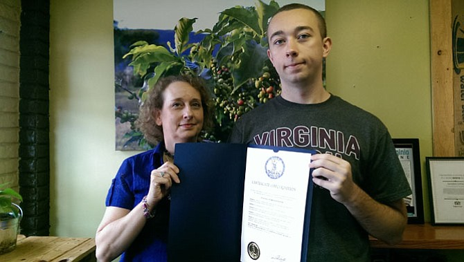 Joan Rizek and her son Calvin of the Fairfax area display the official proclamation from Gov. Terry McAuliffe (D) recognizing October as Dyslexia Awareness Month.