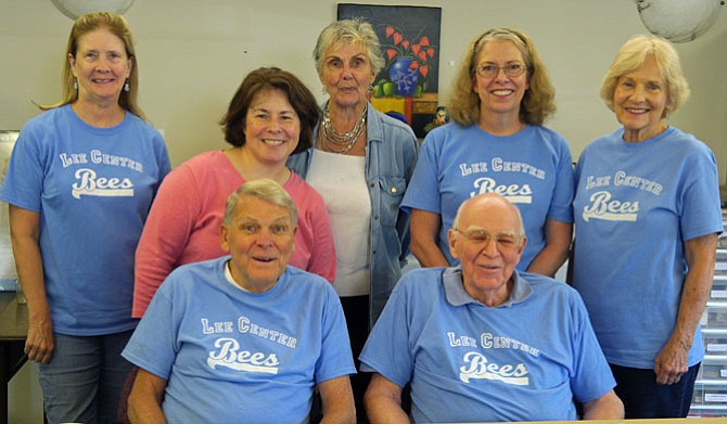 Lee Center Spelling Bee contestants dressed in their blue Lee Center Bees T-shirts include: (from left front) James Shea (winner of the sudden death spell-off), Thomas Kerwin (second sudden death contender); Carol Mackela, Adrianna Carr (director of the Lee Senior Center), Mary Wingo, Catherine Jamieson (contestant pulled from the group at the last minute to serve as judge), and Ruth Ann Neely.