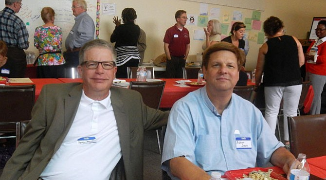 Enjoying the luncheon program are Pastor Brent Thalacker (at left) of Nativity Lutheran Church and Pastor Robert Lewis of Messiah Lutheran Church.
