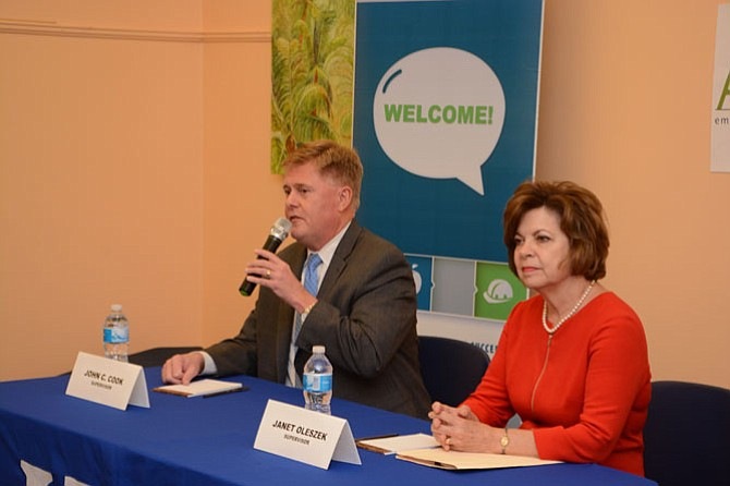 Supervisor John Cook (R-Braddock, left) and Janet Oleszek (right) answer questions at the League of Women Voters of Fairfax meet the candidates event Oct. 8. Oleszek is challenging Cook for the supervisor position.
