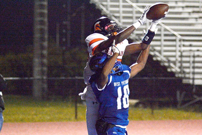 West Springfield receiver Daniel Adu leaps over a West Potomac defender to bring in a 10-yard touchdown reception with 6 seconds remaining in the first half of Friday's win over West Potomac.