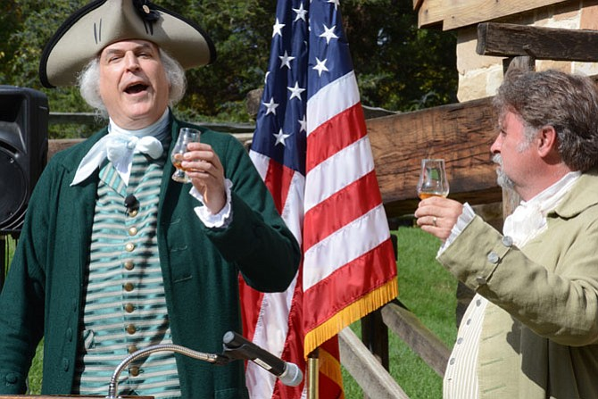 General George Washington (left) and his farm manager James Anderson (right) toast to the completion of a new Single Malt at the gristmill distillery and celebrate continued collaboration and camaraderie with Scotland.