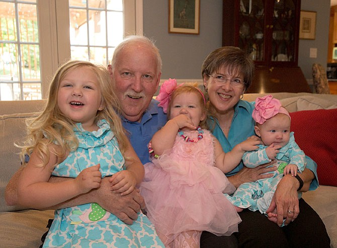 Kathy and Steve Smith with their three granddaughters, (from left) Kathy Cate, Meredith and Caitlynn.