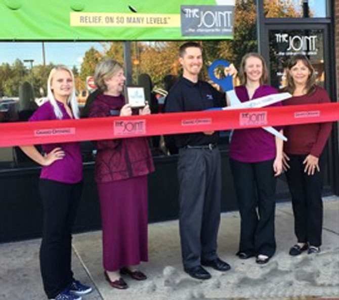 The Joint Chiropractic ribbon cutting at Greenbriar Town Center. From left: Tracy Gilbert, Wellness coordinator, The Joint; Eileen Curtis, president & CEO, Dulles Regional Chamber of Commerce; Jarod Rehmann, DC and Becky Rehmann, DO, co-owners, The Joint; Susan Banville, Chamber representative.