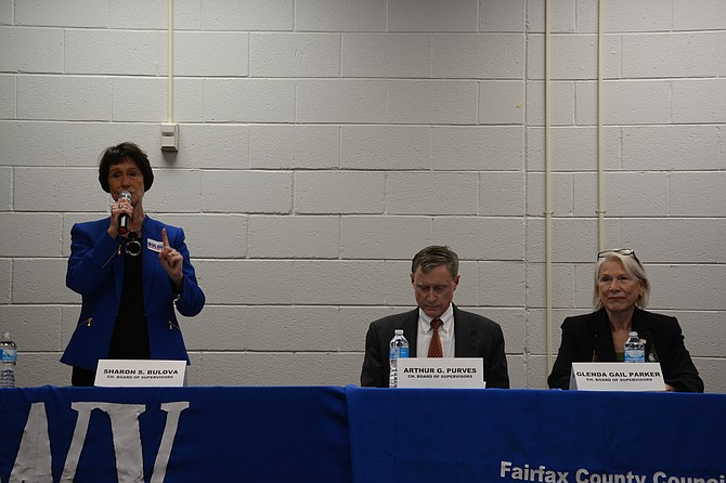 Candidates for Board of Supervisors chairman Sharon Bulova (left, incumbent), Arthur Purves (center) and Gail Parker (right) meet at James Madison High School on Oct. 13.