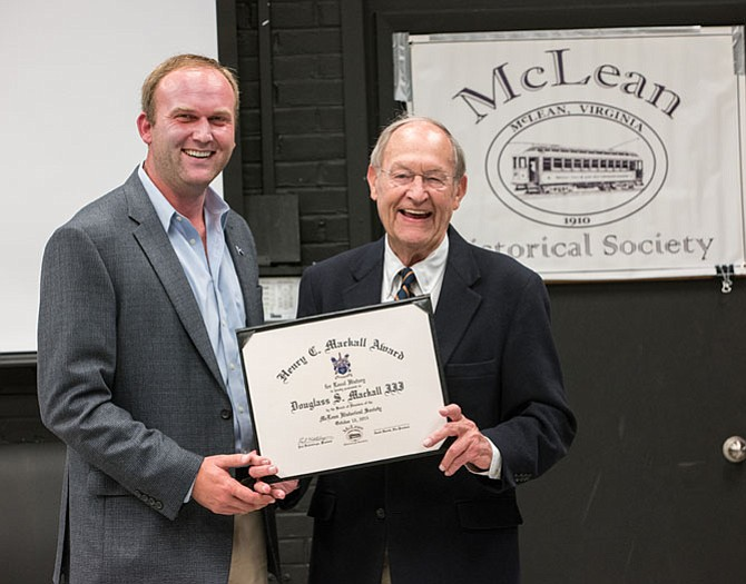 Paul Kohlenberger, president of the McLean Historical Society, presents the Henry C. Mackall Award for Local History to Doug Mackall (right).