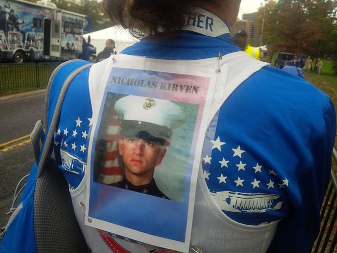 T.A.P.S team runner Beth Belle ran the 10K in memory of her son, Lance Corporal Nicholas Kirven. Kirven, 21, was killed in the line of duty on May 8, 2005, in Alishang, Afghanistan.