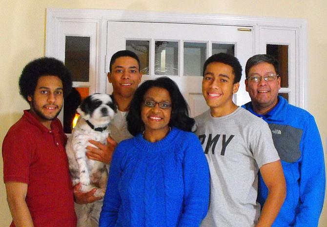 Karen Keys-Gamarra with (from left) sons Jonathan, James (holding family dog Reo) and Jordan, plus husband Antoine Gamarra.
