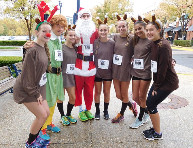Santa and reindeer (from left) Allison Brown, Wade Pisarich, Ally Williams, Steven McCleskey, Jackie Baker, Lexi Cercy, McKenna Palmer and Amy Wikiera.