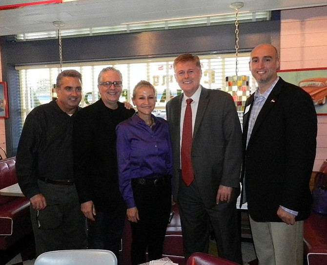 From left, City of Fairfax Mayor Scott Silverthorne, City of Fairfax Council member Michael DeMarco, Fairfax County Sheriff Stacey Kincaid, supervisor John Cook (R-Braddock) and executive director and chief executive officer of Shelter House Joe Meyer met at Chuy's restaurant in Fairfax on Oct. 15 to raise awareness for stopping domestic violence and providing support services for domestic violence victims.