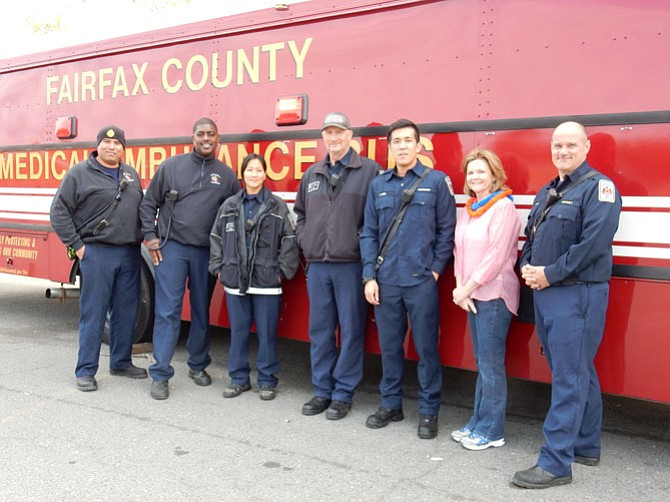 Captain Nicholas Weresnick of the West Springfield Fire Station (far right), Mary Ann Zegeer, PTSA member at West Springfield High School (second to the right) and the West Springfield Fire Station crew who participated in the SpartanFest. They prepared the Fire Truck Demos this year and students also had an opportunity to take a look inside the medical ambulance bus.