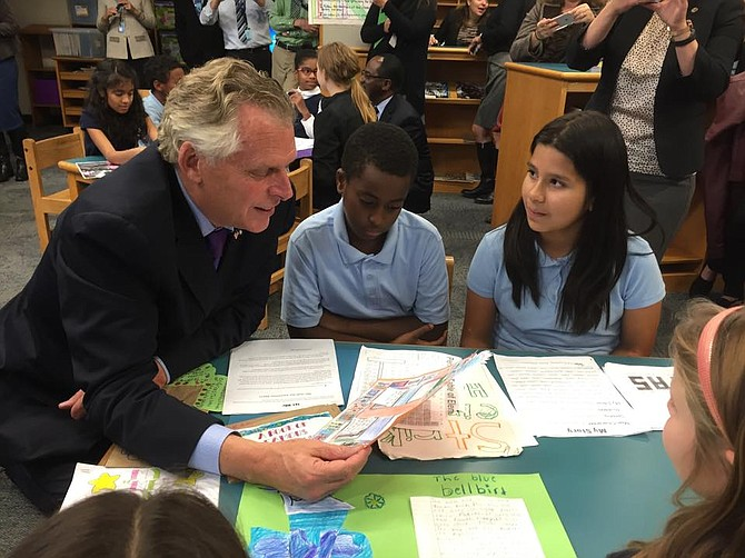 Governor Terry McAuliffe (left) with Patrick Henry students Brock Dotele (center) and Natasha Maldondo (right).