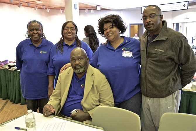 """Juanita Davis, Winnie K. Burns, Anita Helm and Embry Rucker Shelter director Vincent Jenkins stand with Resurrection Baptist Church Pastor William D. Helm. The Church hosted the """"Stand Up for Our Homeless Community"""" outreach event at the Reston Community Center."""
