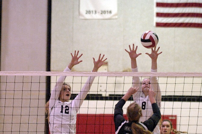 McLean's Sierra Spraker (12) and Maddie McArthur attempt to block a Washington-Lee attack on Monday night.