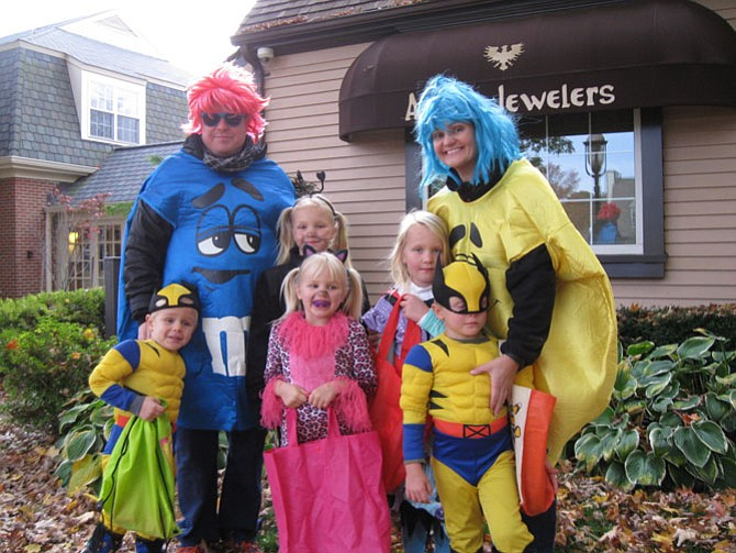 The Dahncke family of Great Falls: Ella, Mia, Talia, Bruno, Lukas, Mark, and Vizma dressed in costumes.