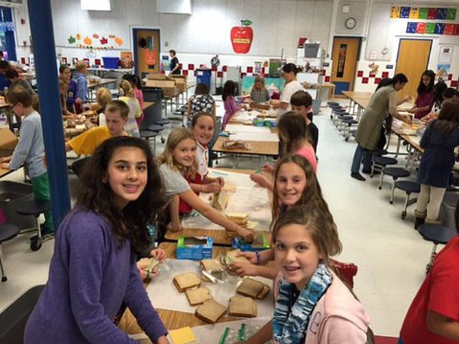 Churchill Road sixth-graders Selina Al-Shihabi, Naomi Redd, Katherine Senich, Angelina Gozzi, Caroline Senich and Noelle Rupli enjoy making sandwiches for Martha's Table.