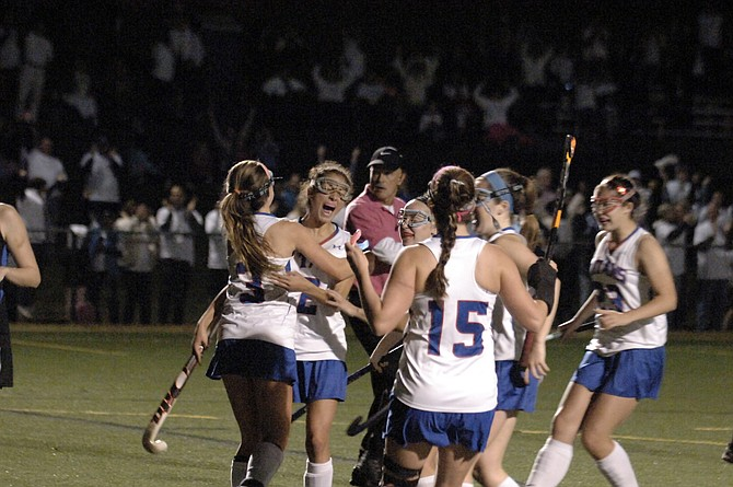 Members of the T.C. Williams field hockey team celebrate during their 1-0 victory over Fairfax during the 6A North region semifinals on Tuesday night at Minnie Howard.