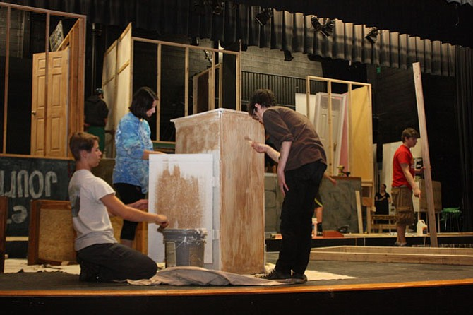 """South County students prepare a piece of furniture for the three-story house set of the comedic play """"Jabberwock."""""""