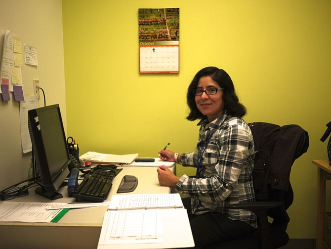 Karina Herrera at work at the newly renovated offices at 2 East Glebe Road.  Herrera is a pharm tech who has been with Neighborhood Health for about 15 years. She works in the Medication Assistance Program.