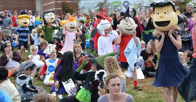 """Best Overall in the Stroller category, """"Peanuts & Gang,"""" work their way through the crowd for the award presentation."""