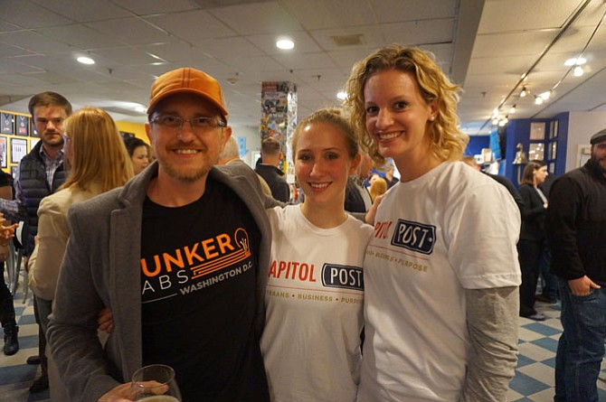 Ray Crowell of The Bunker Labs D.C., left, joins Mary Iafelice and Emily McMahan of the Capitol Post for a Veterans Day eve celebration Nov. 10 at Port City Brewery.