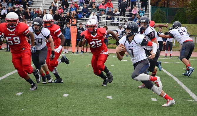 Woodson quarterback Jojo Heisley carries the ball during Saturday's 38-14 win over T.C. Williams.