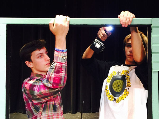 Quinn Partee and Ben Goodson take down the set after rehearsal Sunday at the Langley School.