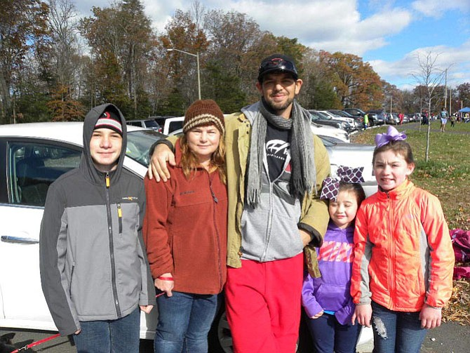 From left, family members Scott and Jean Cummings, of Virginia Beach, Bridget, 6, and Grace, 9, Smith, of Fairfax, attend the first American Kidney Classic lacrosse tournament in support of Matthew Moody, center, who was diagnosed with Goodpasture Syndrome, a rare autoimmune disease.
