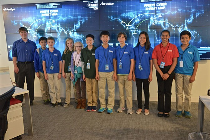 "Members from The Nysmith School's three CyberPatriot Competition teams visited FireEye cyber security company in Reston. The tech savvy students posed with FireEye staffer David Lindquist in front of the ""threat map"" in the company's local operations command center."