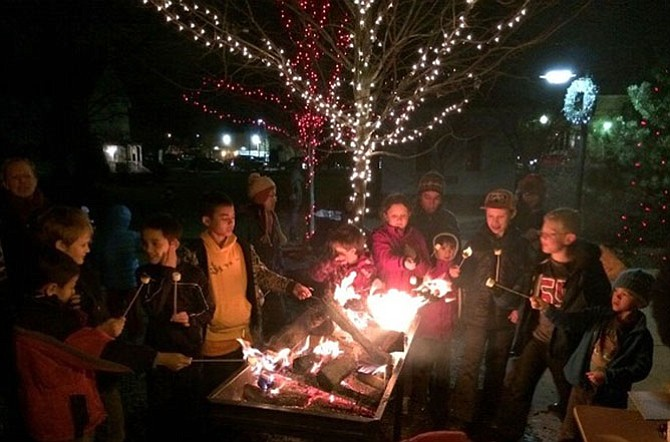 Roasting of marshmallows is one of the favorite activities during the annual stroll.
