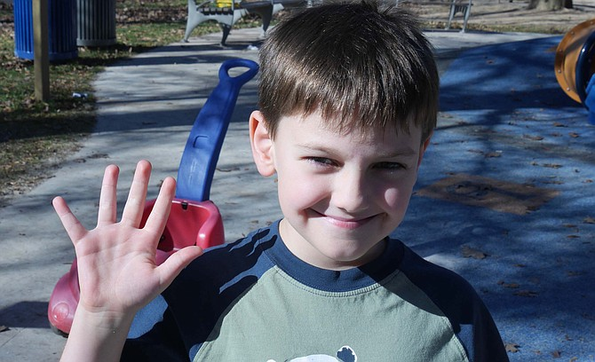"""Alex LaBonte, 7 years old, whose family is moving to Arlington in December, is grateful for """"my family, my friends and food — cheese pizza!"""" His parents have brought Alex and his brother to see his new house and to play in the local park a block away."""