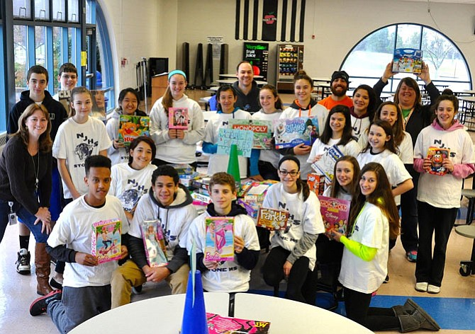 Members of Stone Middle School's National Junior Honor Society at last year's Panther Drop-Off with gifts donated to Our Neighbor's Child.