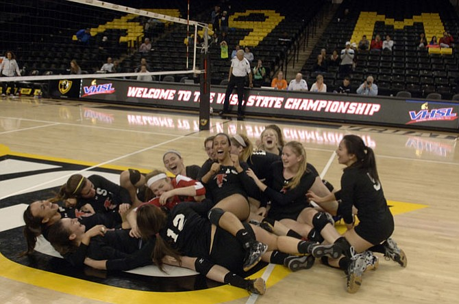 Madison volleyball players celebrate their five-set victory over Langley in the 6A state championship match on Nov. 20 at VCU's Siegel Center in Richmond.