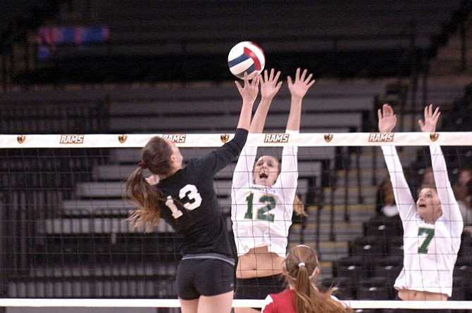 Langley sophomore Elena Shklyar (12) totaled 16 kills, 18 assists and seven blocks against Madison in the 6A state final on Nov. 20 at VCU's Siegel Center in Richmond.