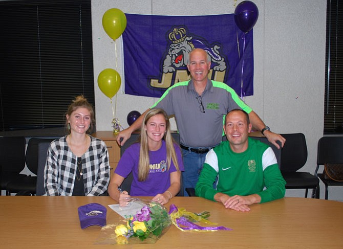Langley senior Halle Duenkel on Nov. 13 signed a National Letter of Intent to play lacrosse at James Madison University. Pictured from left: Langley lacrosse coach Maggie Kovacs, Duenkel, Principal Fred Amico and DSA Geoff Noto.