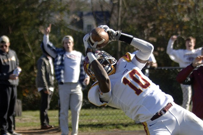 Bishop Ireton receiver Corey Johnson attempts to bring down a pass in the end zone during Saturday's state championship game against Benedictine. Johnson was ruled out of bounds.
