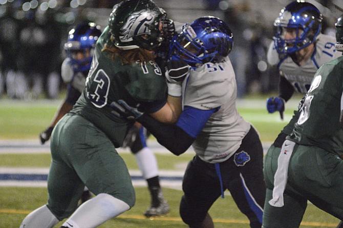 West Potomac senior lineman Ozzie Opoku, right, earned second-team All-Conference 7 honors this season.