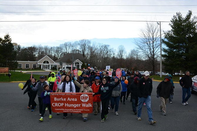 Walkers begin their 3.7-mile journey from Living Savior Lutheran Church in Fairfax Station by crossing Ox Road with help from Fairfax County Police from the West Springfield station.
